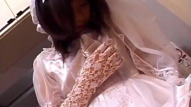 Nami Asakura in wedding dress sucks cock and rubs it with gloves