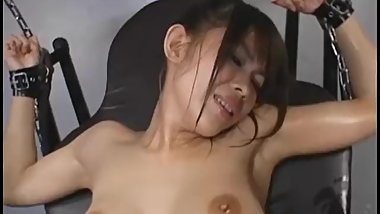 Sexy Asian babe with great tits is tied to chair and teased with sex toys