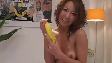 Luna Mikami rubs cock of her oiled big cans and with feet for cum