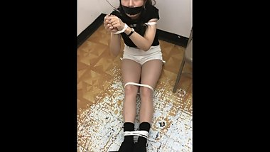 Asian Esther is Tied up and Gagged with Black tape