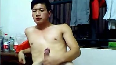 Hot and cute Asian guy wanks and cums on cam