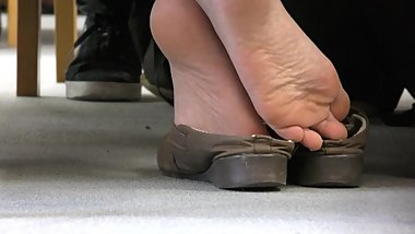 candid shoeplay in library
